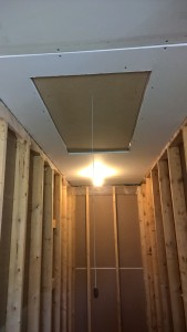 Drywall above stairwell