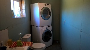 Washer and dryer stacked in place