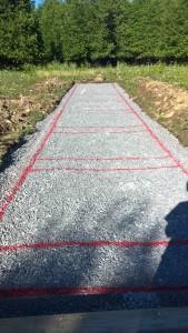 Gravel pad marked for blocks