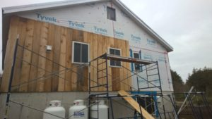 East gable end siding, first course, 1/2